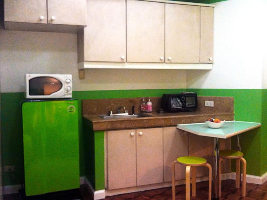 The Kitchen - comes with the apple green refrigerator, toaster, coffee maker and microwave