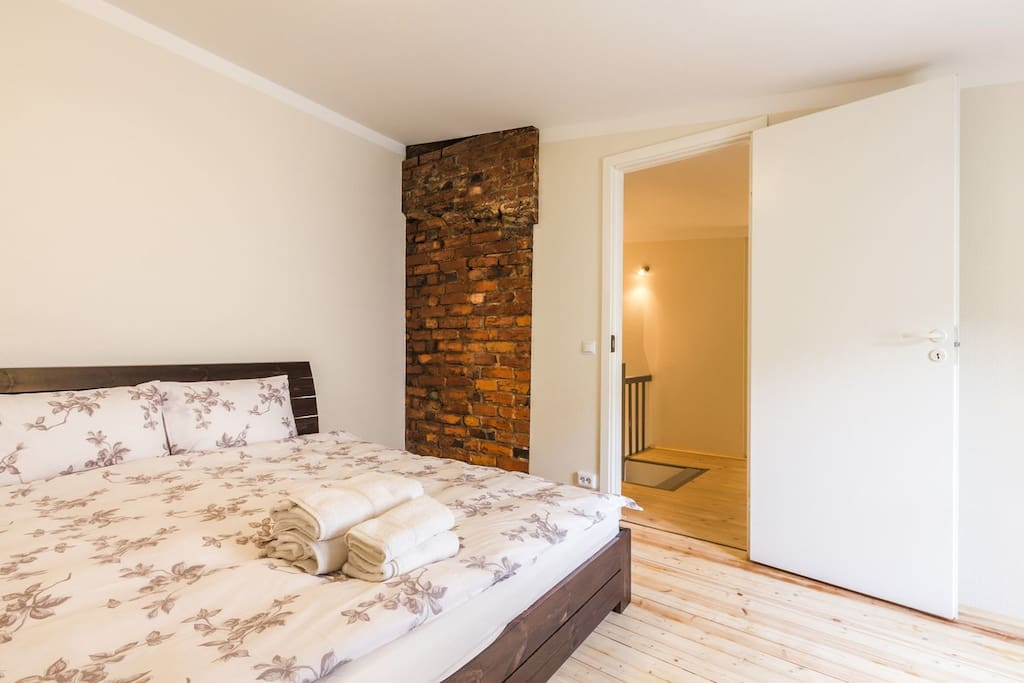 Bedroom 1 - This is the larger bedroom, with a king size bed with an...