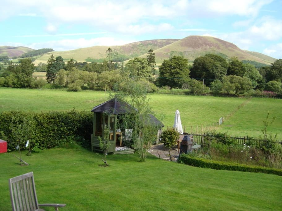 view from the house; the summerhouse and the hills