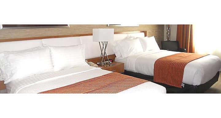 ✨ One Bedroom Two Queens Room