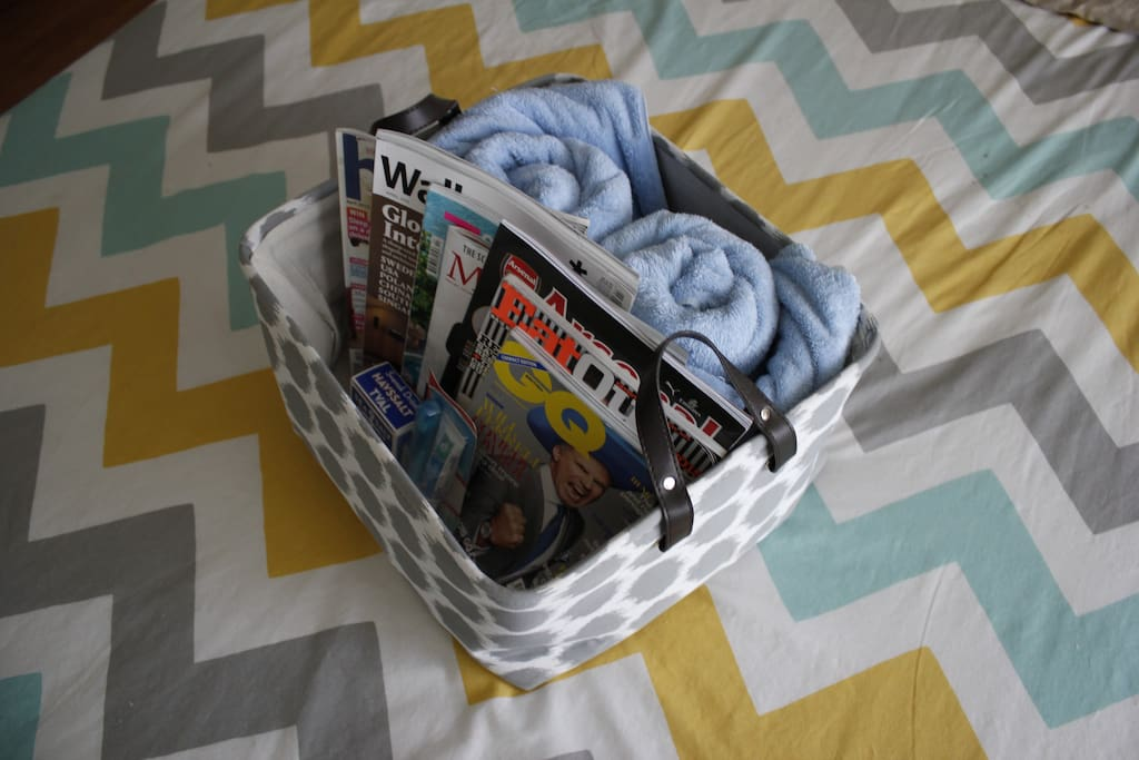 Welcome basket of global magazines, towels, and necessities you may have forgotten!