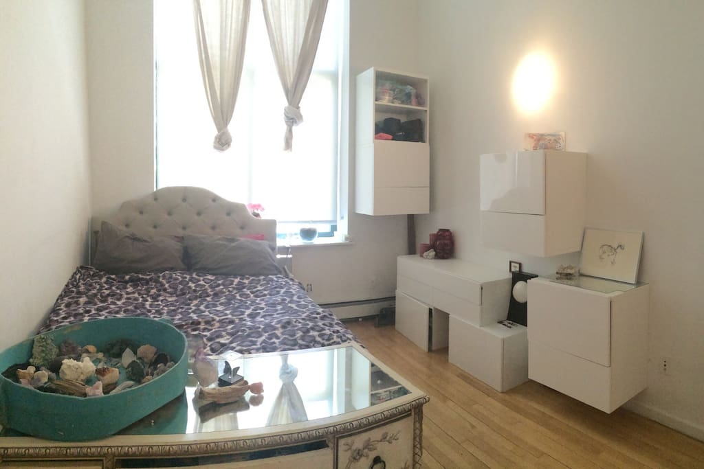 Large bedroom with super big Windows. Queen sized bed