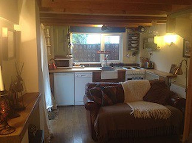 Cosy beamed sitting room with kitchen