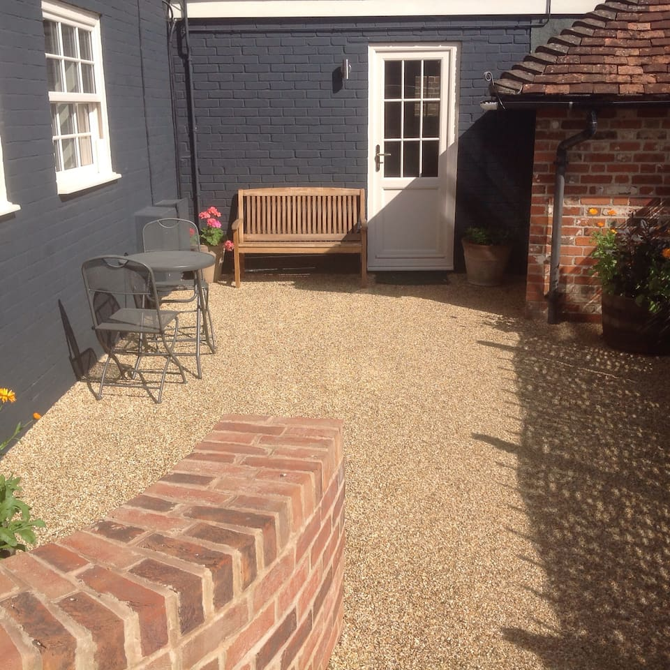 Private entrance to flat and outdoor area. Private parking off street adjacent to door through gate