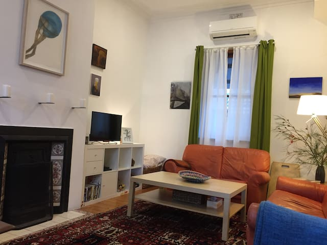 Living room is spacious and bright, with a comfortable, good quality sofa, ceiling fan, open fire place, aircon, Sony TV and DVD player and NETFLIX