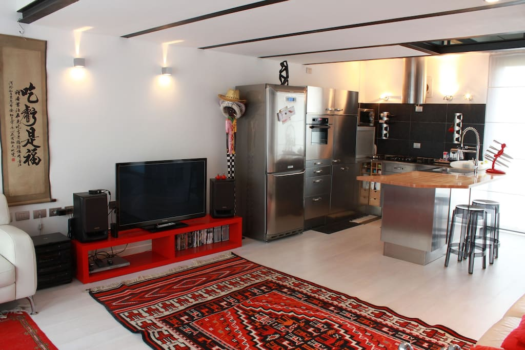 the wide living and the open kitchen