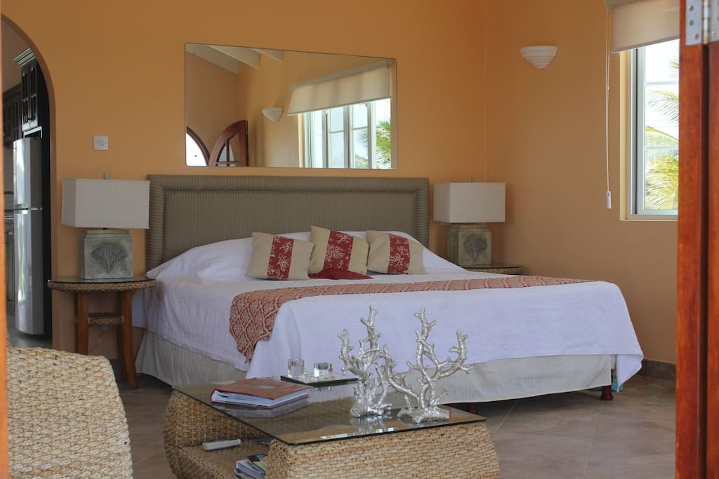 Wouldn't you love to relax in this comfy king size bed while enjoying the lovely bajan sea breeze?