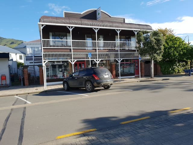 Wonderfully appointed apartment with extensive seaviews from spacious 1st floor balcony on the main street in Akaroa