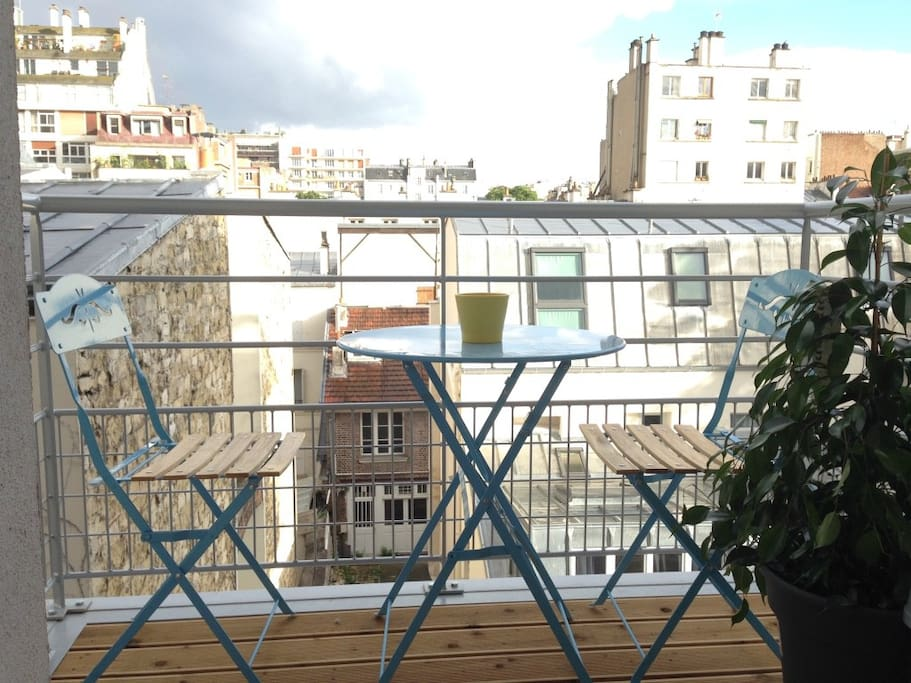 Balcony overlooking the roofs of Paris