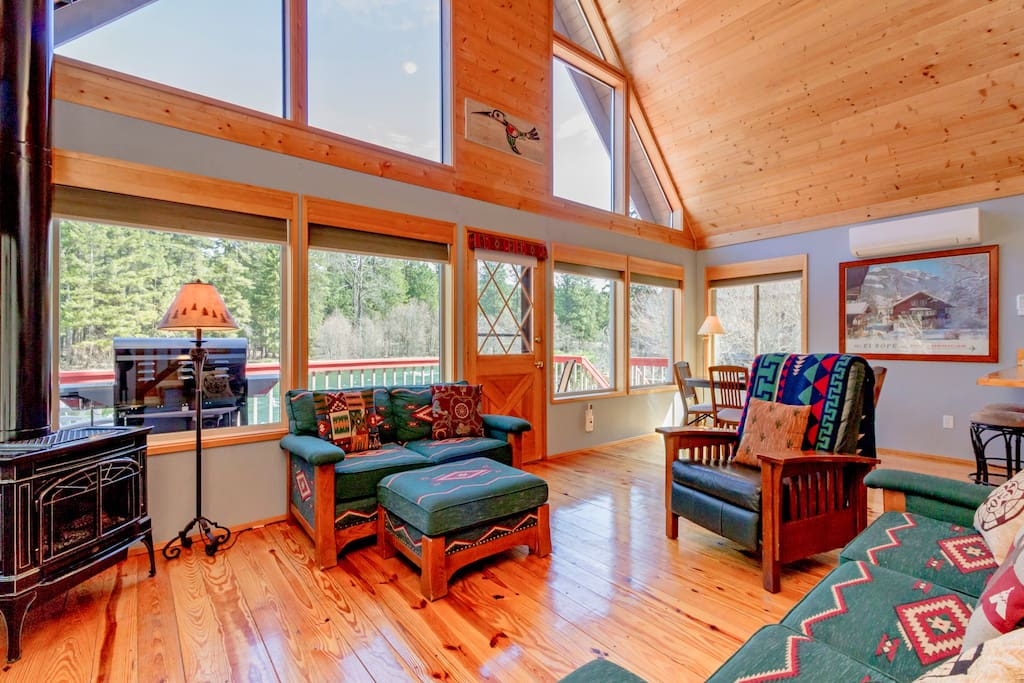 Soaring vaulted ceiling with big windows for taking in the river views!