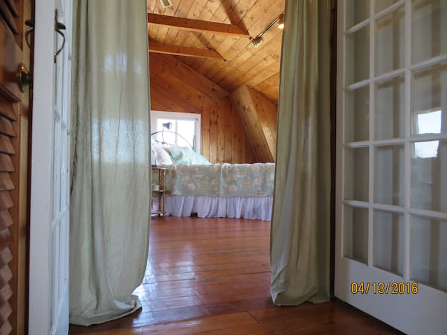 Upstairs master bedroom with 10 windows with panoramic ocean and beach views.