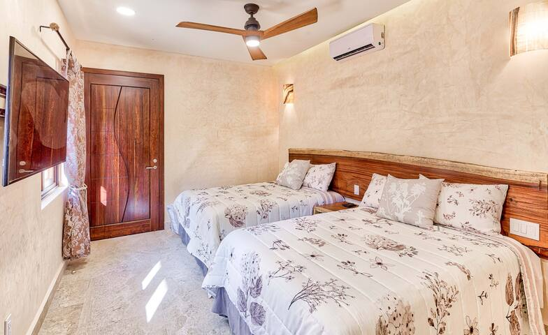 """Guest Bedrooms 1 & 2 are identical. Each has two comfort plus double beds, AC, Fan, 50"""" Flat Screen Smart TV, two large windows with Courtyard Views, Ceiling Fans and large closets and bathrooms"""