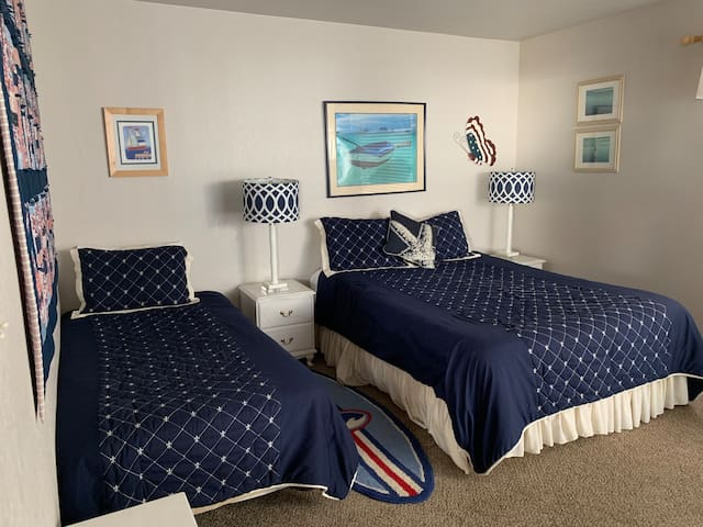 Upstairs guest bedroom with 1 twin bed and 1 queen sized bed. Private deck
