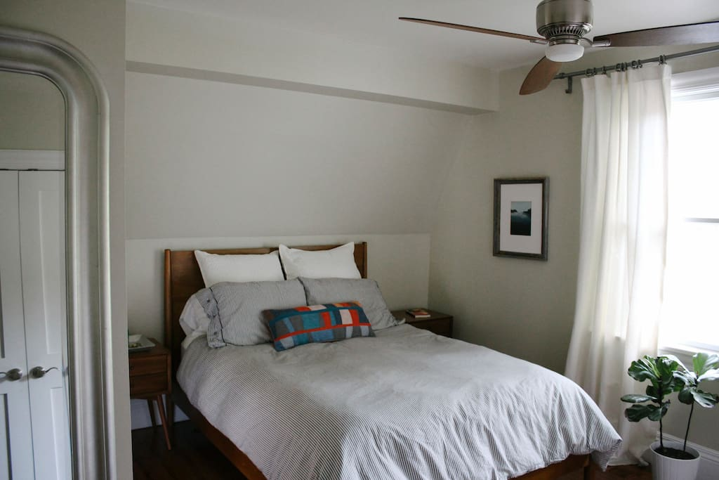 Two bedrooms upstairs. This one has a queen bed and a big window into the backyard.