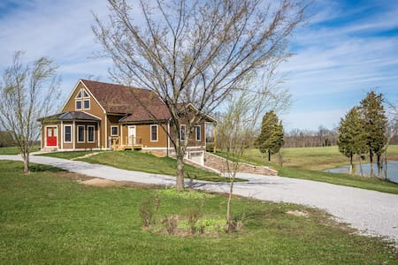 Spacious home with private lake and stables