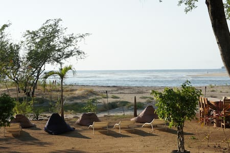 Beach front, sea view, right on the beach, 5 minutes walk from the center, but on a quiet place. King-Size, air cond.,CTV, fridge,safe,...  Tamarindo, Costa Rica +(506)-8429 3968 open 24h/24 Price Range: $$  http://www.losmangos-tamarindo.com