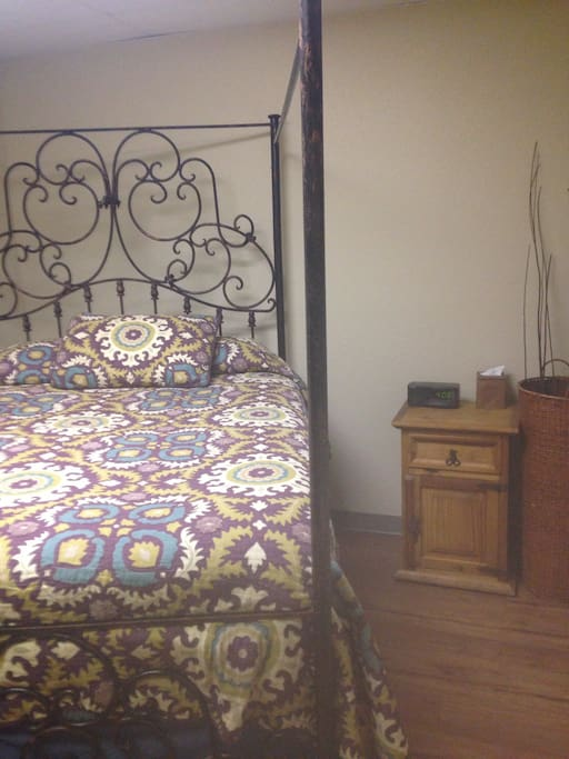 Queen size bed with couch and dresser. The largest of the rooms for 2 people.