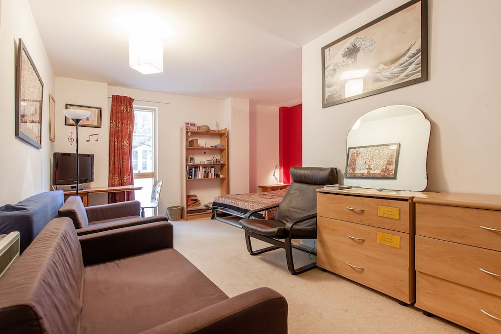 The bedroom has 2 sofas and armchair for your comfort.