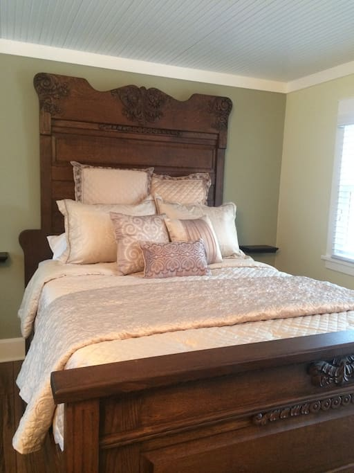 Queen size antique bed with feather top mattress!