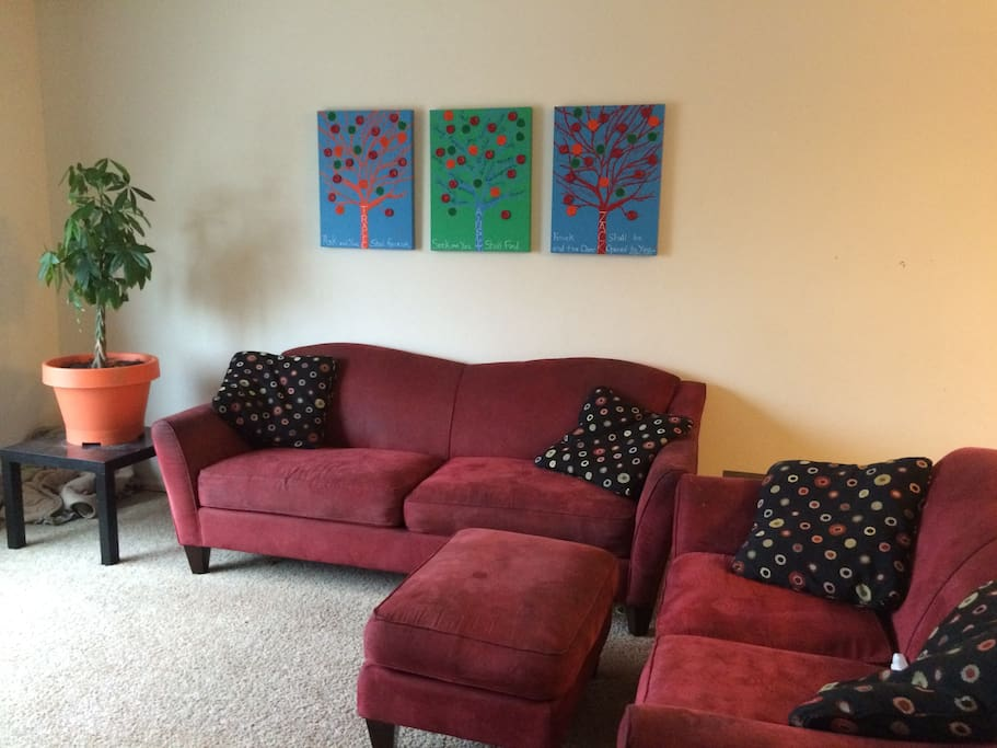 Bright and cheerful living room, could use couches for sleeping if your group is large