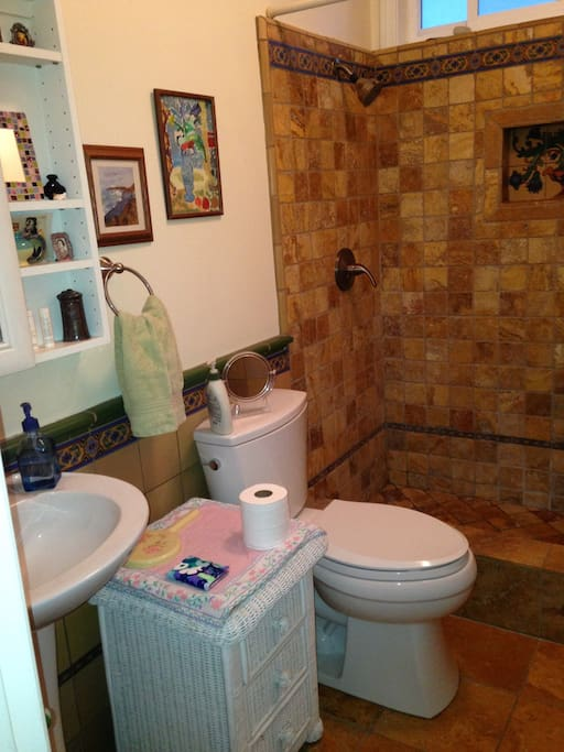 Beautifully tiled and clean bathroom for you.