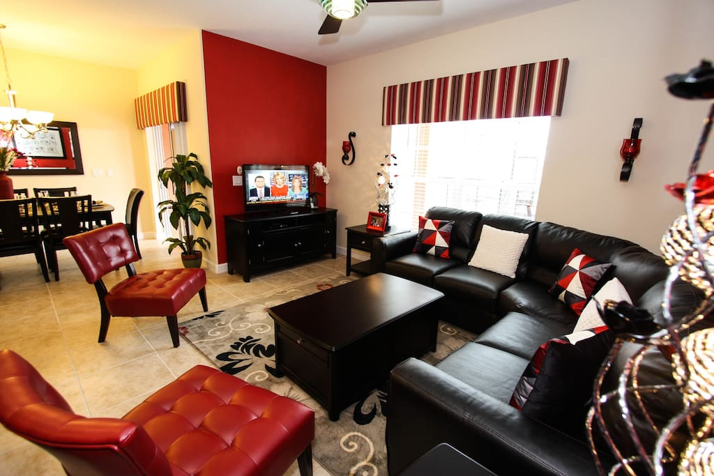 LCD TV with DVD player, leather couch for your comfort seating