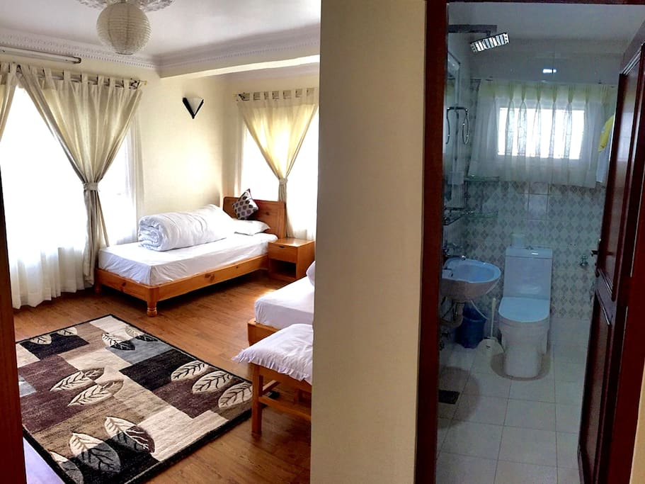 Twin Bed Room with attached bathroom.
