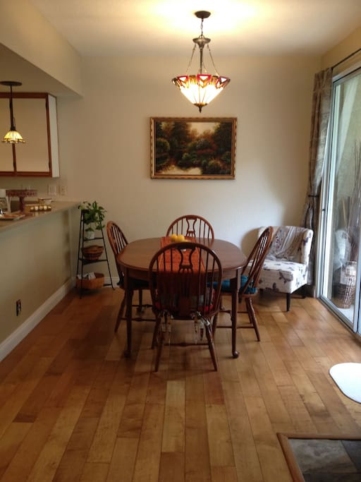 Natural wood floors highlight the dining room area