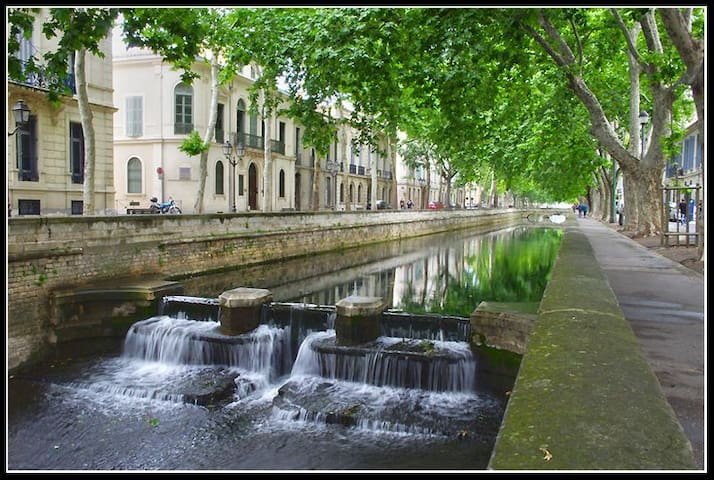 Charming apartment along the canal apartments for rent in n mes languedoc roussillon france - Jardin de la fontaine nimes limoges ...