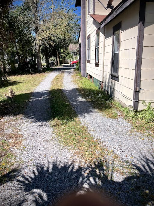 This is the driveway that leads to the back parking area behind the house.