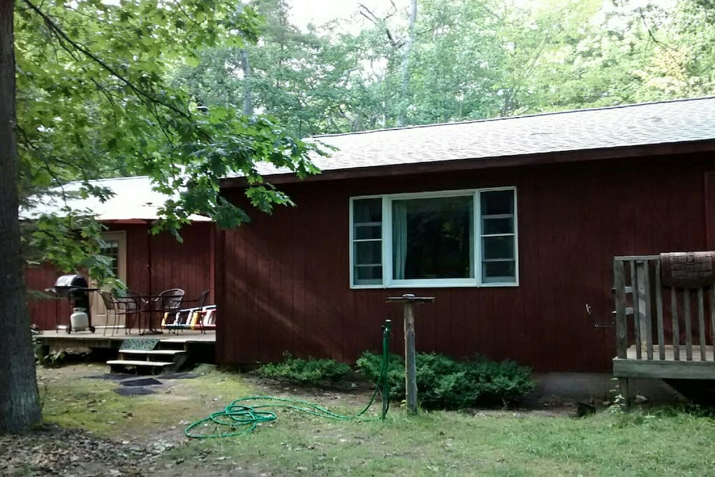 South Side of the house showing partial front porch and back porch.