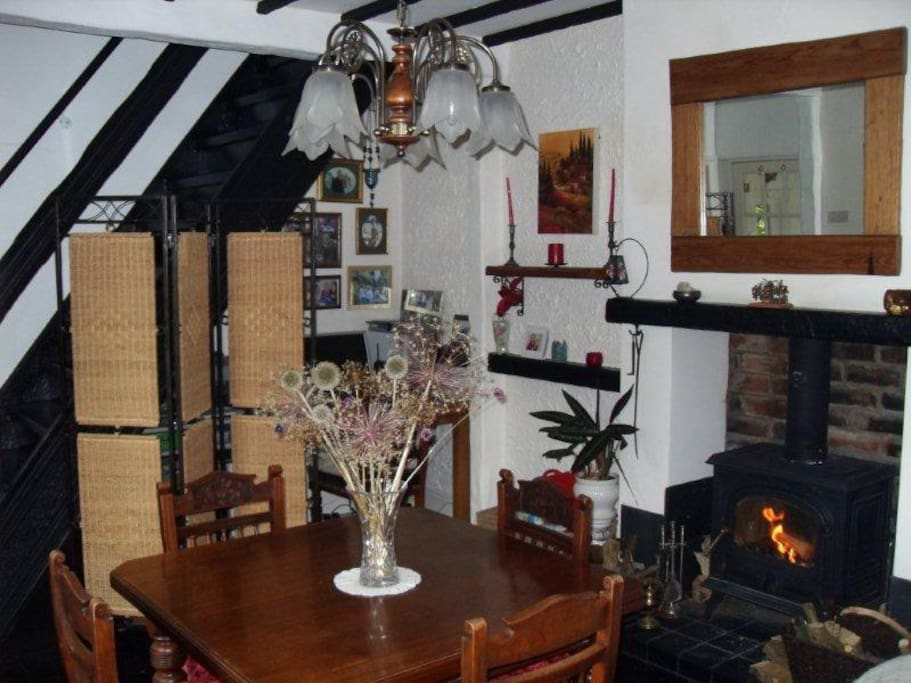 Dining Room with wood burner and beams
