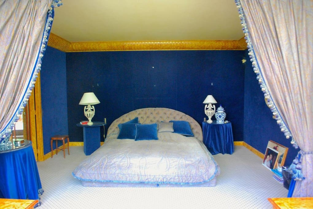 A gorgeous master bedroom featuring a king-size bed