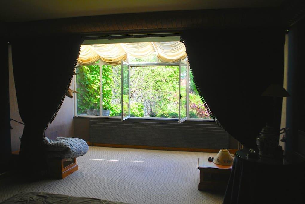 The master bedroom overlooks the garden