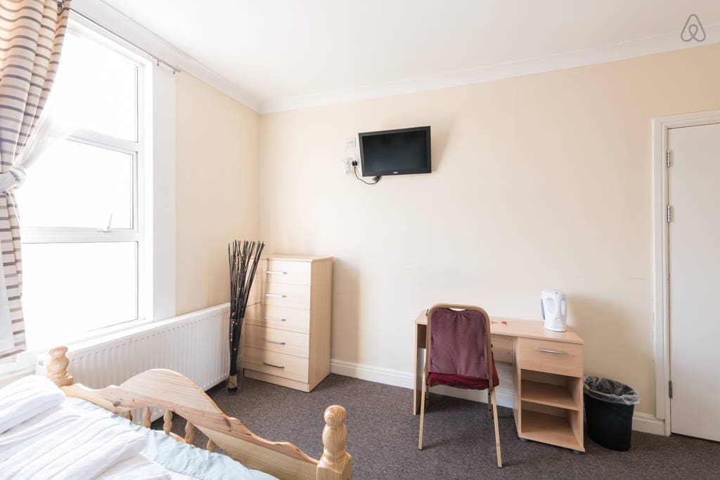 Desk, chest of drawers, wardrobe with hangers and wall mounted TV are in every room