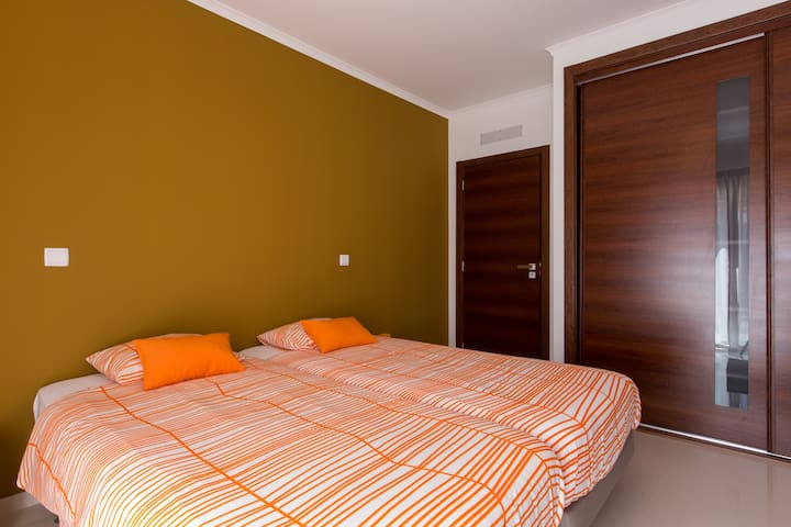 Comfortable hotel-style beds with bunk bed for 3rd and 4th person