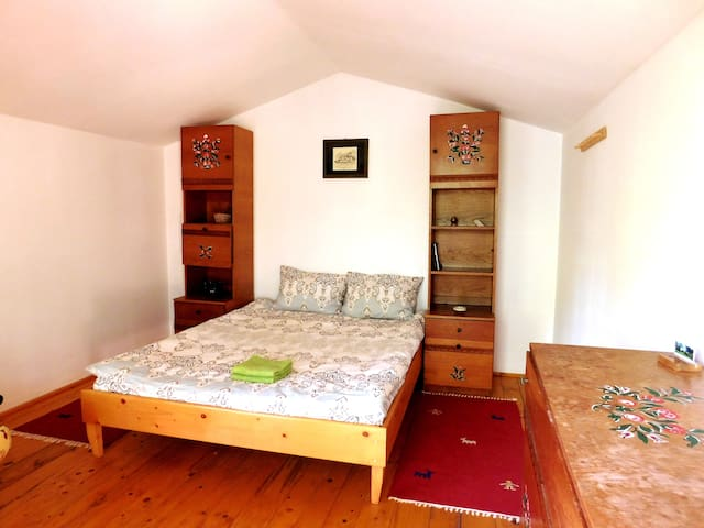 double bed in Wood Cabin No. 4