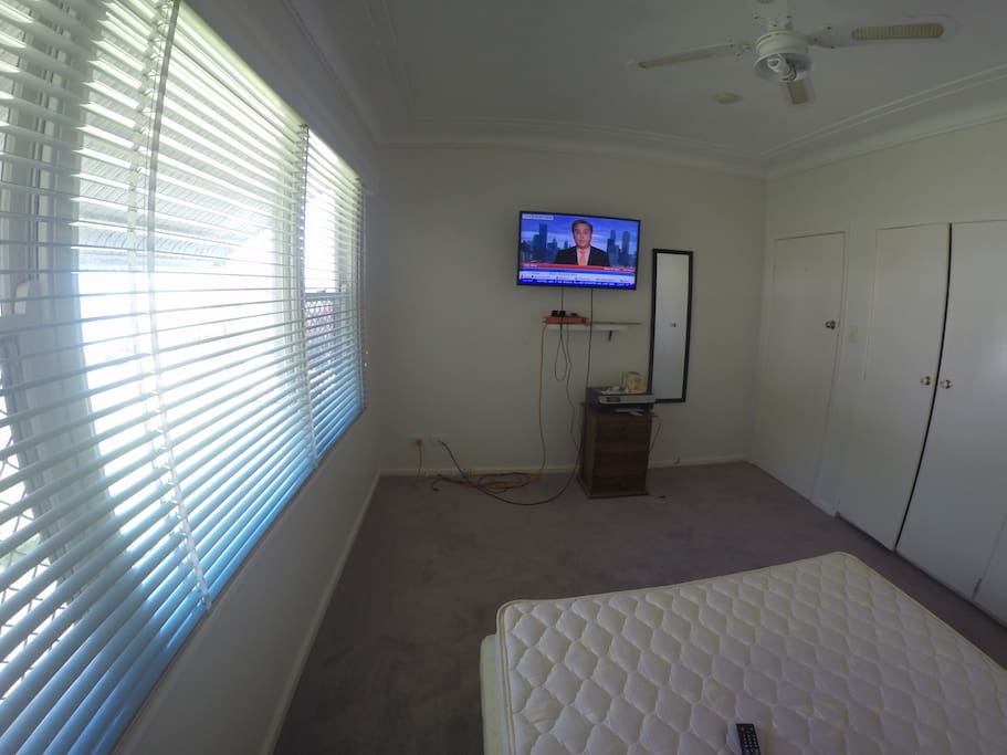 Large room double bed, TV, Builtins, AC, Ceiling Fan.