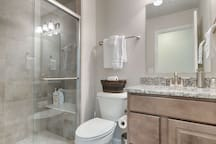 Full bathroom located on the main level just outside the bedroom with twin beds.