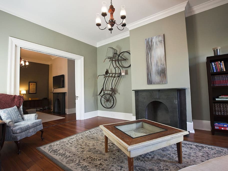 Enter the house through the parlour with original slate fireplace and mantle.