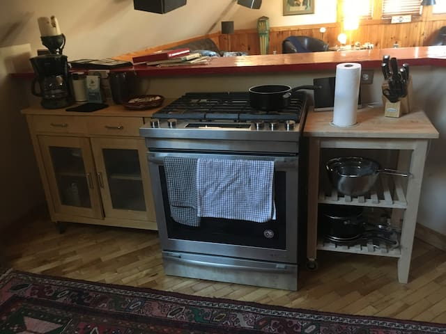 Everything pictured included with the space. We have a fully prepared coffee station on arrival as well as everything needed to cook yourself any and all meals Also included: microwave.