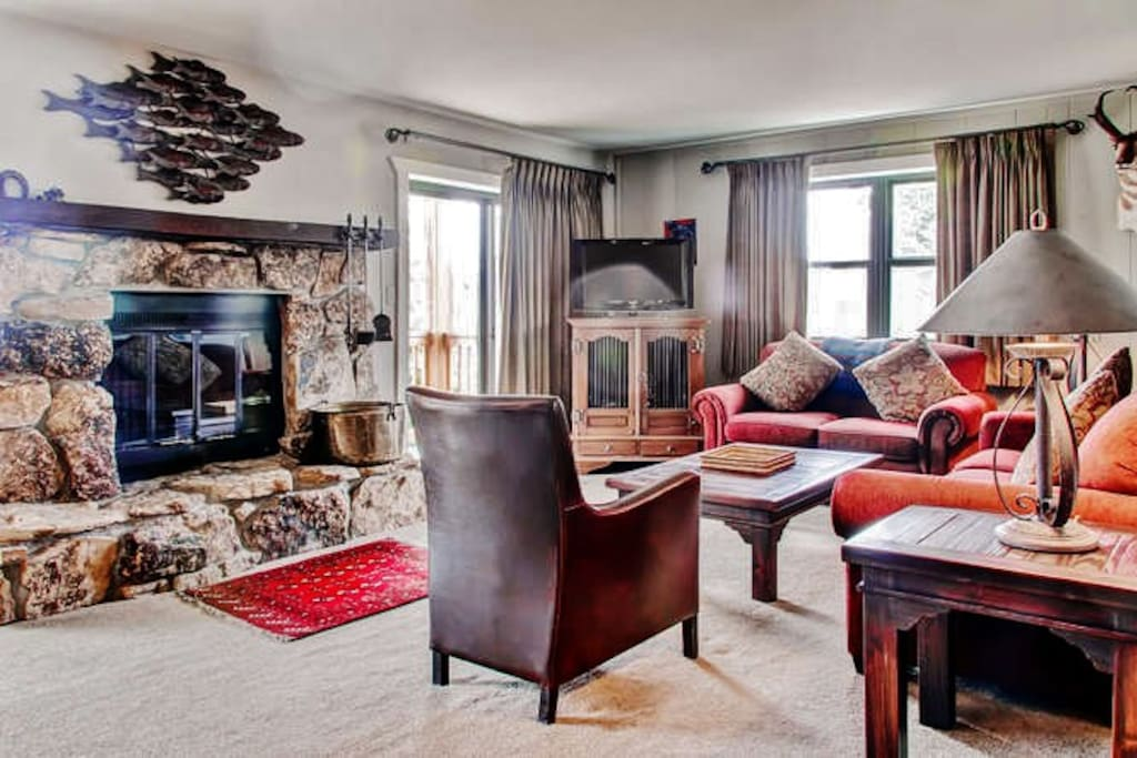 Cozy up by the fireplace in the condo's inviting living room