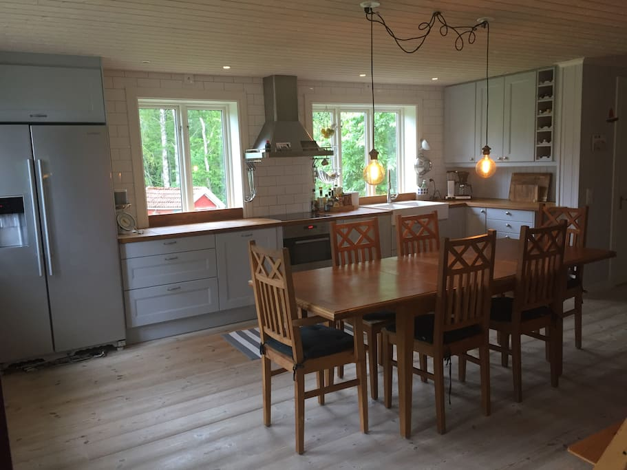 The kitchen is located next to the entrance and is spacious with modern equipment.