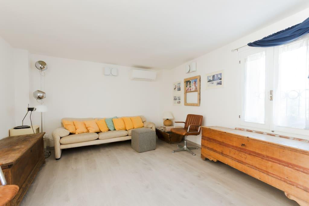 The living room: sofa, table & tv