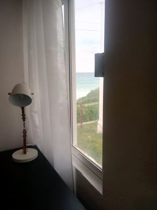 View of the beautiful Isla Mujeres Sea from your bedroom. Wake up to the waves and breeze in paradise.