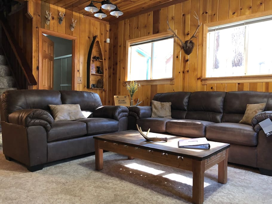 """Cozy Living Room complete with a 42"""" HDTV, streaming TV through Sling TV,  Netflix, Playstation3 with games and DVD/BluRay capabilities."""