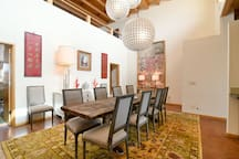 The dining area is open to the kitchen and well furnished