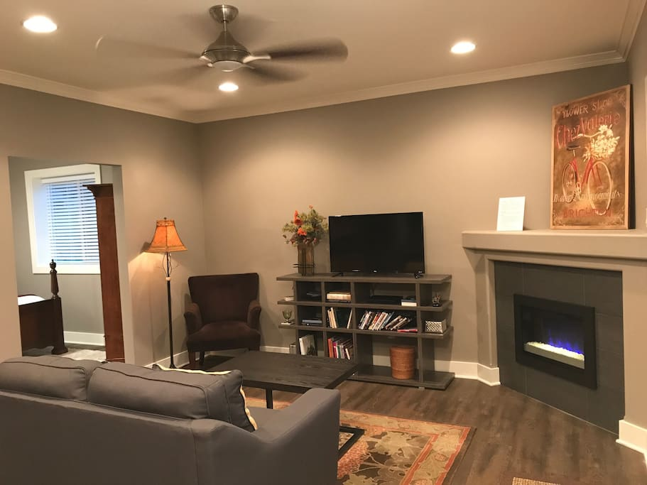 Private living area with electric fireplace, Roku TV & DVD player