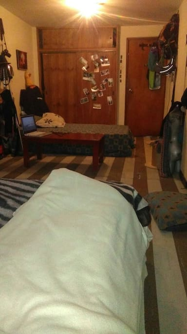 This is the room. Is quite big and it has room for two beds that are showed in the picture