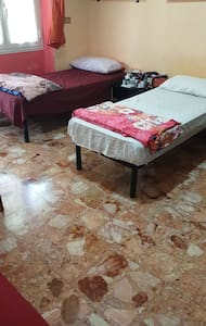 A bed in a double room, near the city centre